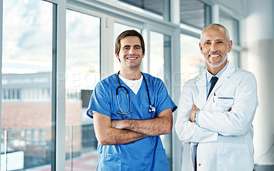 Buy stock photo Portrait of two medical practitioners standing together in a hospital