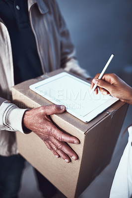 Buy stock photo Shot of a unrecognizable man handing over a package to a customer and letting them sign on a digital tablet