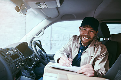 Buy stock photo Portrait of a cheerful young delivery man seated in his car with boxes while signing on a digital tablet during the day