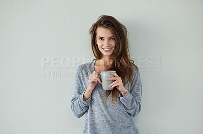 Buy stock photo Studio shot of an attractive young woman drinking coffee against a white background