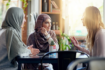 Buy stock photo Shot of a group of women chatting in a cafe