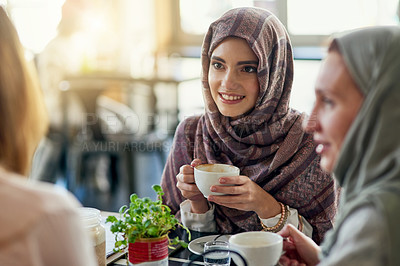 Buy stock photo Shot of a group of women chatting over coffee in a cafe