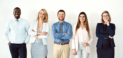 Buy stock photo Portrait of a group of confident work colleagues standing with their arms folded against a white background