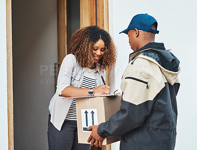 Buy stock photo Shot of a young woman signing for her delivery from the courier