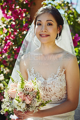 Buy stock photo Portrait of a cheerful young bride holding a bouquet of flowers while standing outside during the day