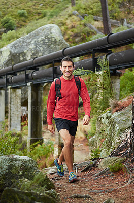 Buy stock photo Shot of a sporty young man out for a run