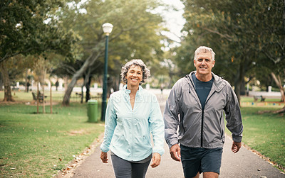 Buy stock photo Portrait of a senior couple out for a walk in the park
