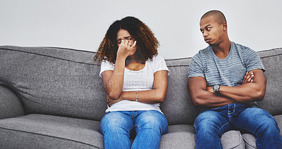 Buy stock photo Shot of a young couple having relationship problems at home