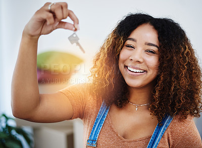 Buy stock photo Cropped shot of a beautiful young woman holding house keys in her new home