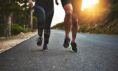 Buy stock photo Low angle shot of an unrecognizable couple out running together