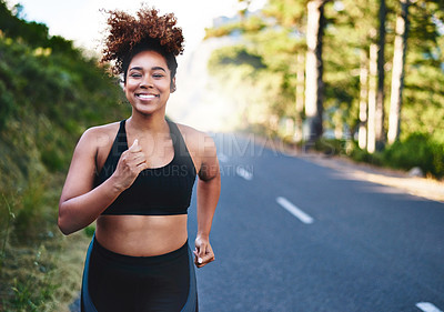 Buy stock photo Cropped shot of a beautiful young woman out for her morning run