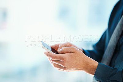Buy stock photo Cropped shot of an unrecognizable businessman sending a text message