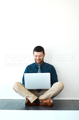 Buy stock photo Full length shot of a handsome mature businessman working on his laptop