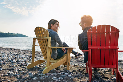 Buy stock photo Shot of a married couple enjoying a day at the lake