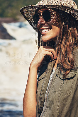 Buy stock photo Shot of an attractive young woman spending a day in nature