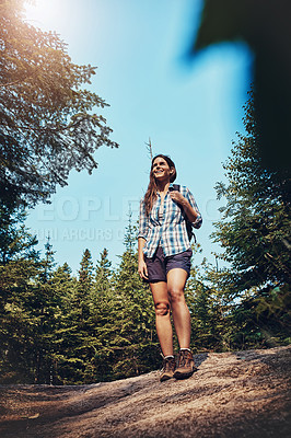 Buy stock photo Shot of a young woman going for a hike through nature
