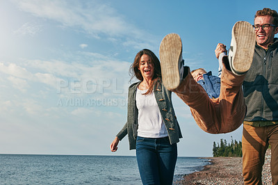 Buy stock photo Shot of a young family spending a day at the lake