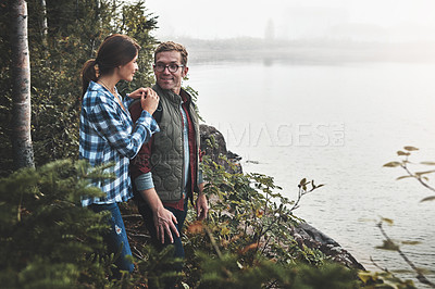 Buy stock photo Shot of a young couple exploring nature together