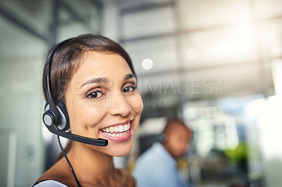 Buy stock photo Cropped shot of a young attractive female customer support agent working in the office