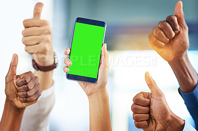 Buy stock photo Cropped shot of a group of businesspeople giving thumbs up and holding a mobile phone in a modern office