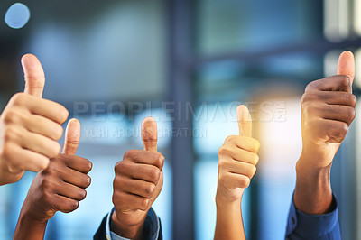 Buy stock photo Cropped shot of a group of businesspeople giving thumbs up in a modern office