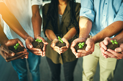 Buy stock photo Closeup shot of a group of unrecognizable businesspeople holding plants growing out of soil