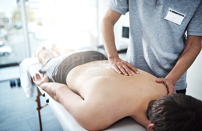 Buy stock photo Closeup shot of an unrecognizable physiotherapist treating a patient