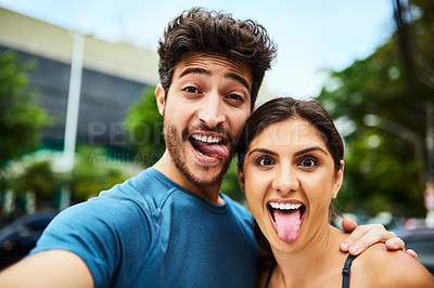 Buy stock photo Portrait of a sporty young couple taking a selfie together outdoors