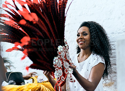 Buy stock photo Cropped shot of a beautiful dancer getting ready for a performance during carnival