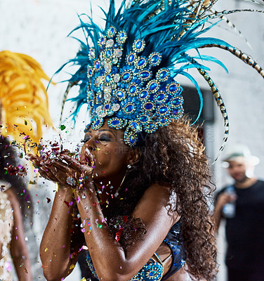 Buy stock photo Cropped shot of a beautiful samba dancer performing in a carnival with her band