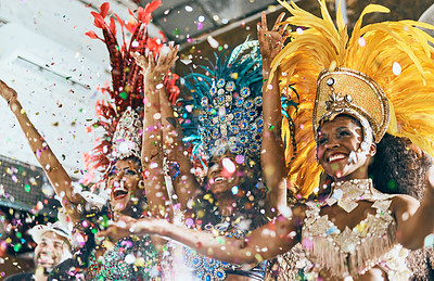 Buy stock photo Cropped shot of beautiful samba dancers performing in a carnival with their band
