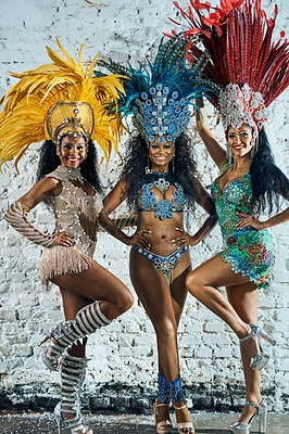 Buy stock photo Shot of beautiful samba dancers posing against a wall outside