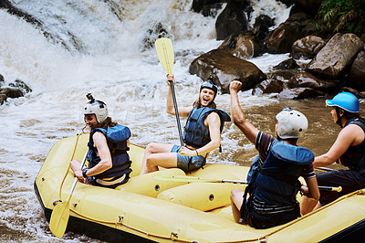 Buy stock photo Shot of a group of cheerful young men in a rubber boat celebrating on making through a challenge outside during the day
