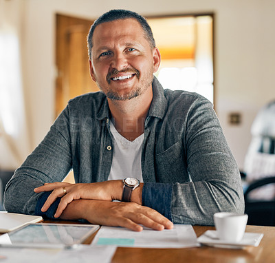 Buy stock photo Cropped shot of a man planning his family budget at home