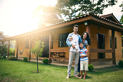 Buy stock photo Full length portrait of a happy young family of four outside with their house in the background