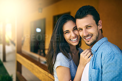 Buy stock photo Shot of a happy young couple spending time together in their backyard