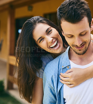 Buy stock photo Cropped portrait of an affectionate young couple standing outside with their house in the background