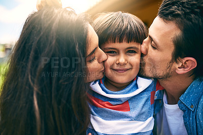 Buy stock photo Cropped shot of a young mother and father kissing their son while outside in their yard