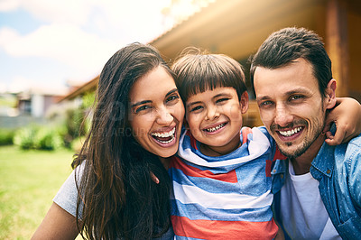 Buy stock photo Cropped portrait of a happy young family of three sitting outside in their backyard