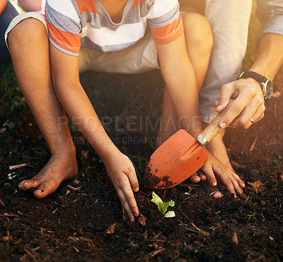 Buy stock photo Closeup shot on a little boy gardening with his father outdoors