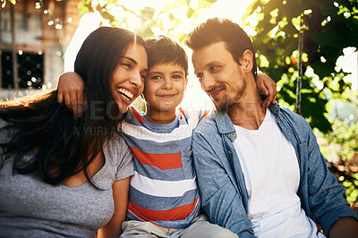 Buy stock photo Portrait of an adorable little boy bonding with his parents outdoors