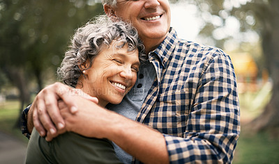 Buy stock photo Shot of a happy senior couple embracing in the park