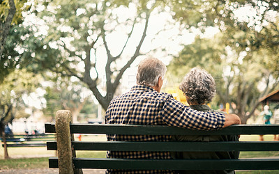 Buy stock photo Rearview shot of a senior couple relaxing on a park bench
