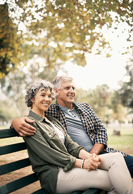 Buy stock photo Shot of a happy senior couple relaxing on a park bench