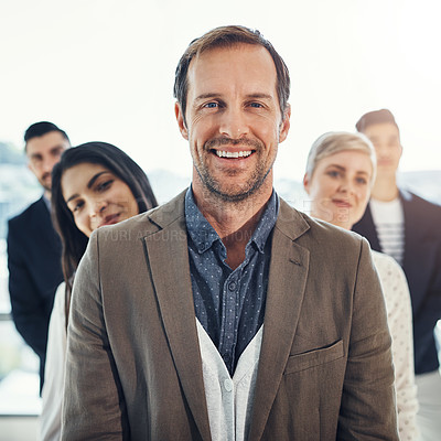 Buy stock photo Portrait of a diverse group of businesspeople standing in a line in an office