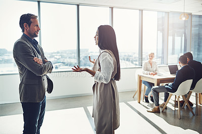 Buy stock photo Shot of businesspeople having a discussion in an office