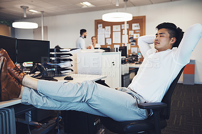 Buy stock photo Shot of a businessman taking a break in the office