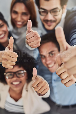 Buy stock photo Portrait of a group of businesspeople showing thumbs up in an office