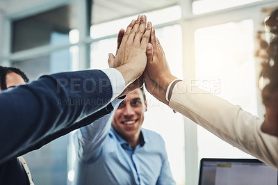 Buy stock photo Closeup shot of an unrecognizable group of businesspeople high fiving in an office