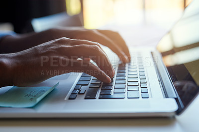 Buy stock photo Cropped shot of an unrecognizable male designer working on a laptop in his office